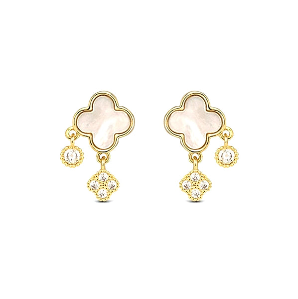 Golden four-leaf clover earrings decorated with mother of pearl and dangling crystals displayed on white background