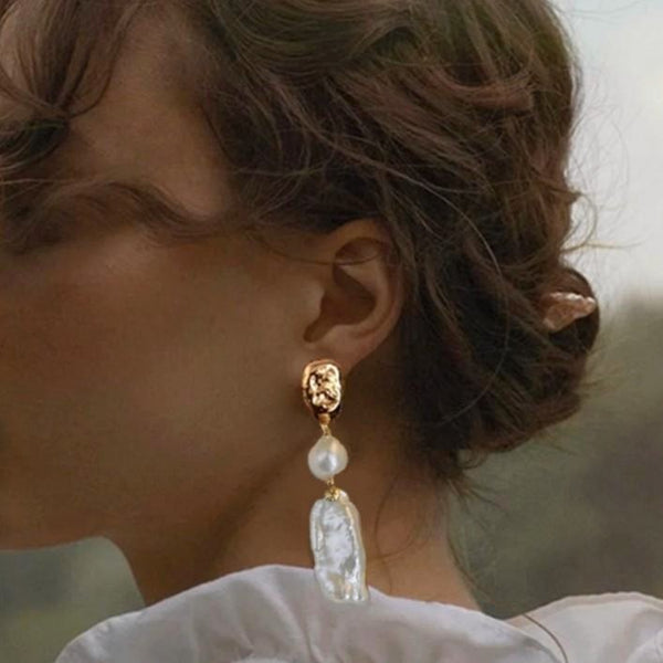 gold double pearl earring on model
