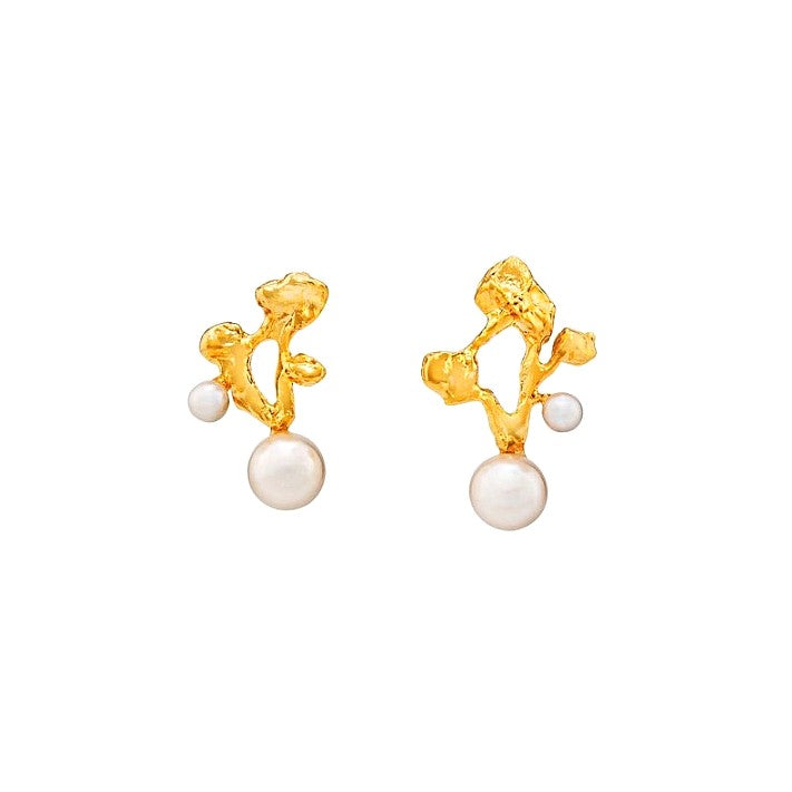 golden pearl drop earrings accentuated with organic holes and pearls displayed on white background