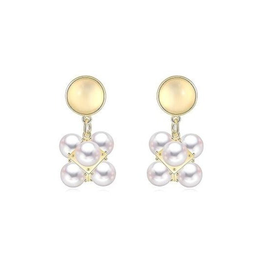 pearl cubic drops suspended from a light yellow opal stud displayed on white background