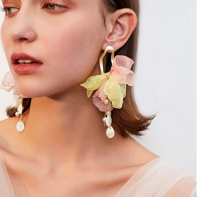 gold fabric flower drop earrings in yellow and blush color on model