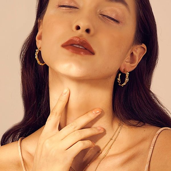 small textured gold hoops on model