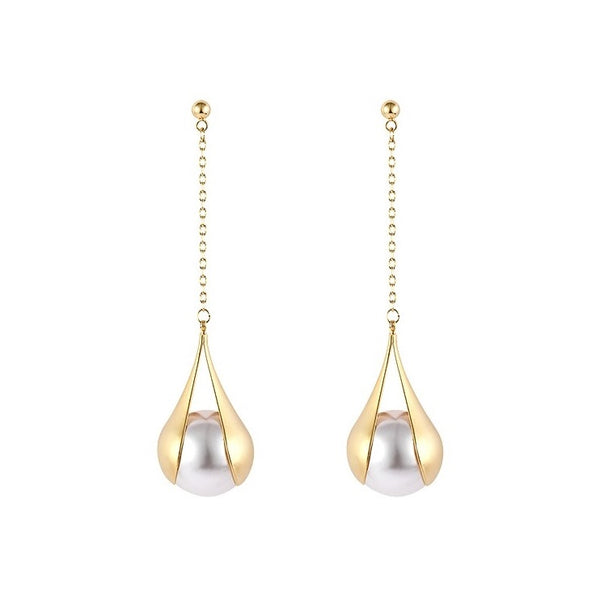 golden pearl drop earrings displayed on white background