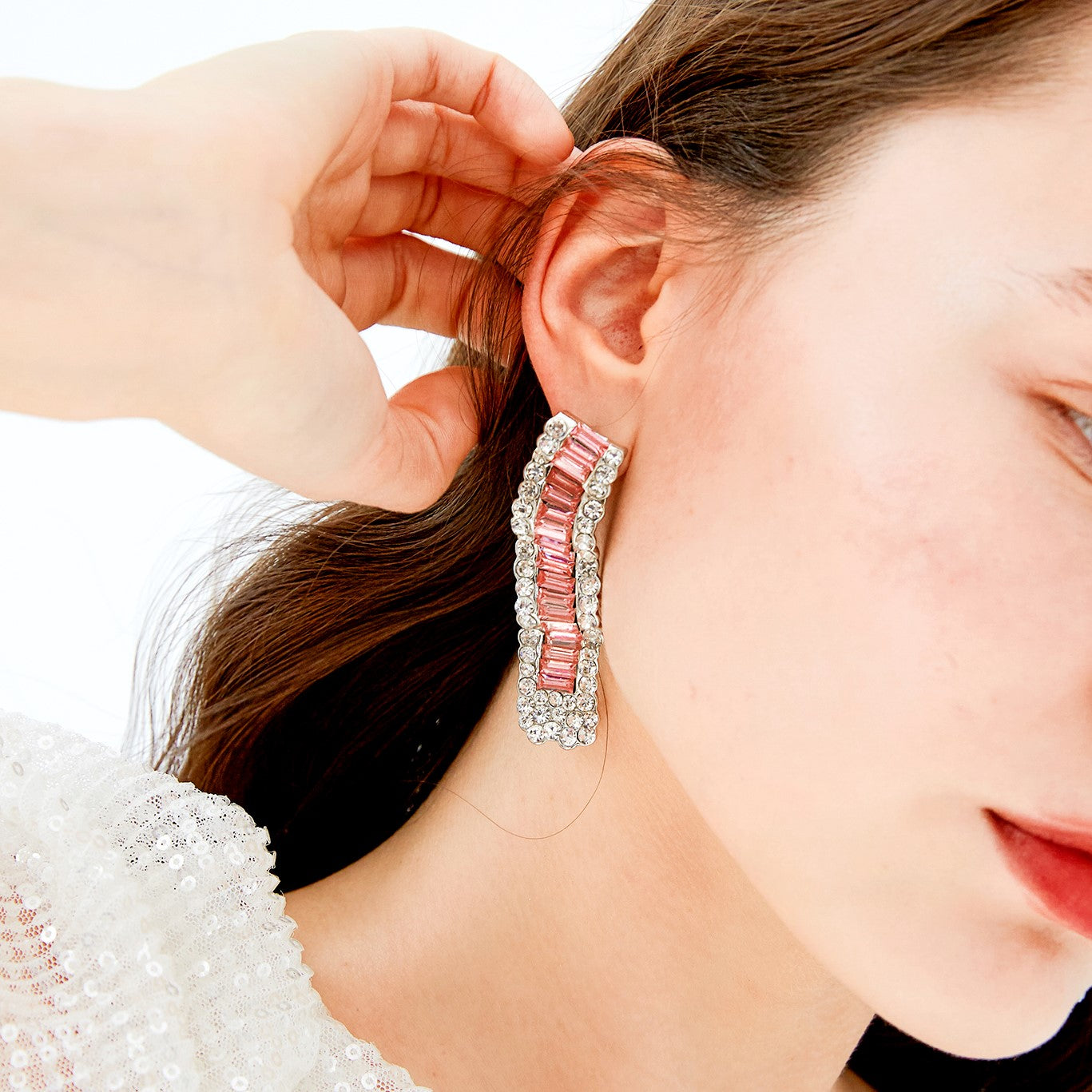 pink textured crystal drop earring on model