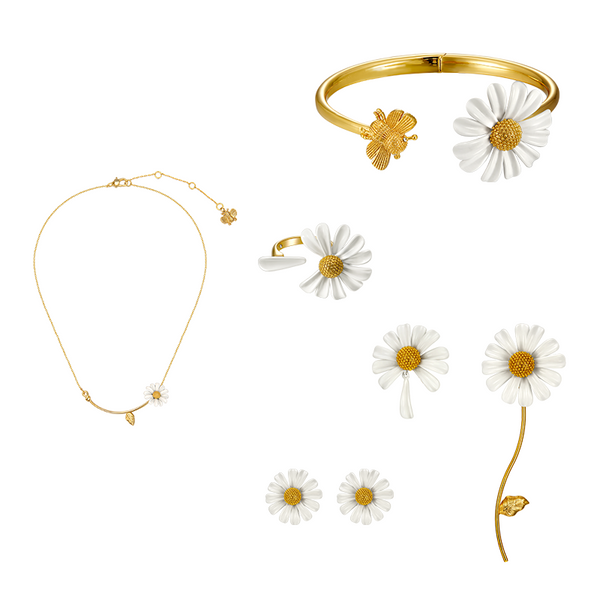 enamel painted daisy jewelry set displayed on white background