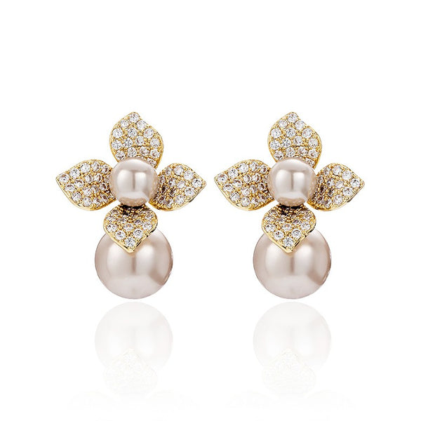 champagne gold floral pearl studs displayed on white background