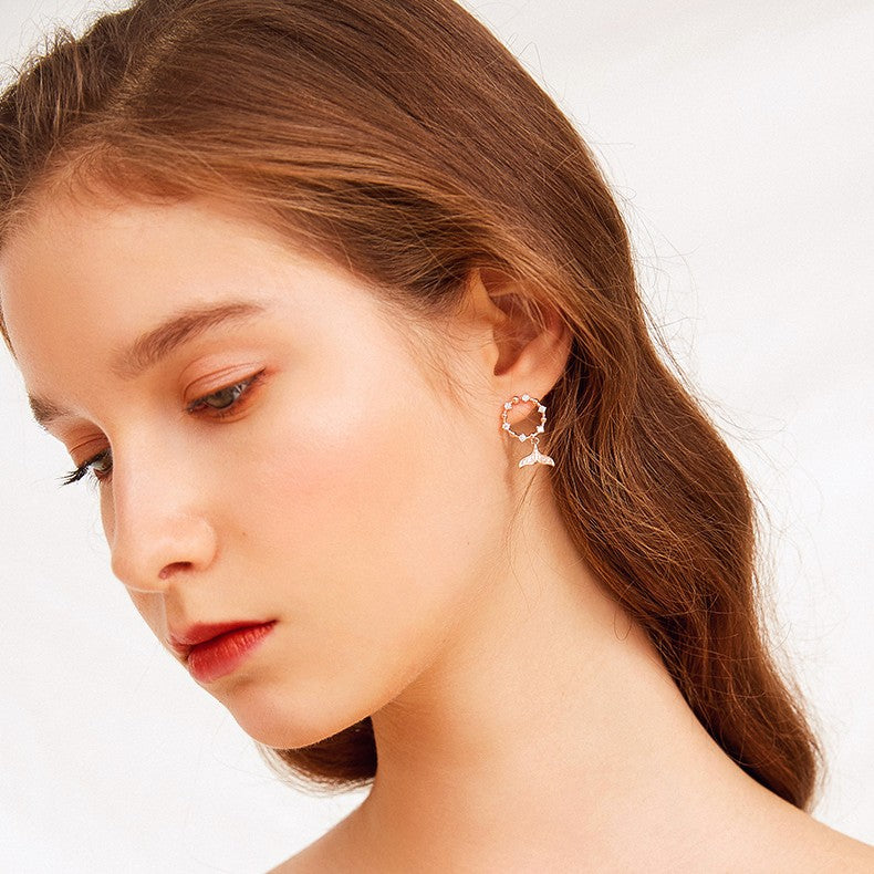 mermaid drop hoop earring on model