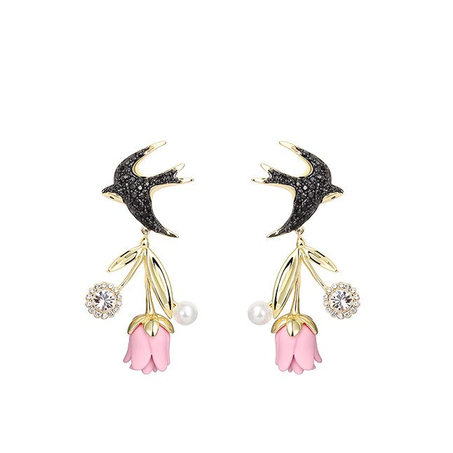 rhinestone earrings with black rhinestone birds and dangling pink flower with pearl decor