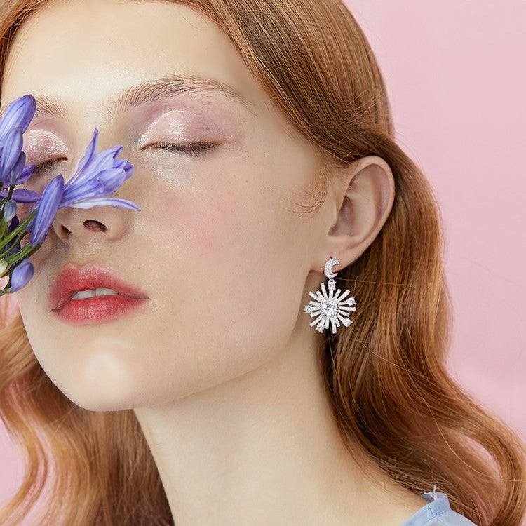 crystal star radiance drop earring on model