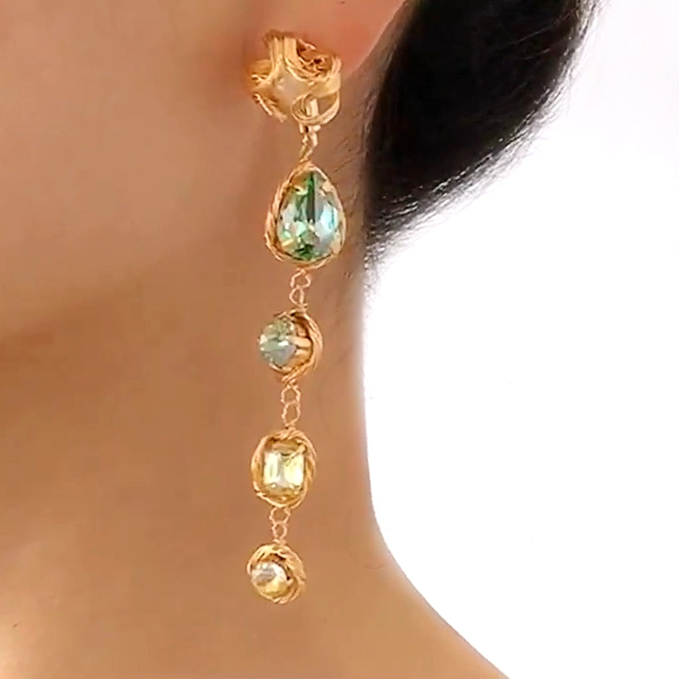semi-precious stone drop earrings featuring pearl flower motif displayed on model