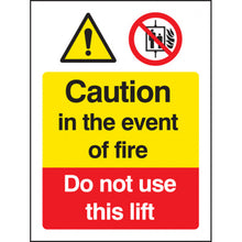 Load image into Gallery viewer, Caution in the Event of Fire - Do Not Use this Lift Safety Sign   Available in Rigid Plastic and Self-Adhesive Vinyl  Sizes: 200x150mm and 300x250mm