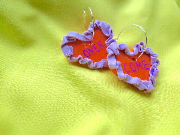 Baked by Lou polymer clay statement heart hoops, with painted text