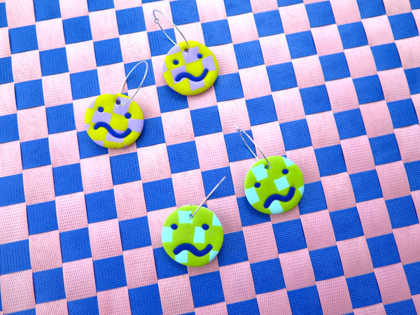 Baked by Lou polymer smiley face worried face statement hoop earrings, limited edition checkerboard