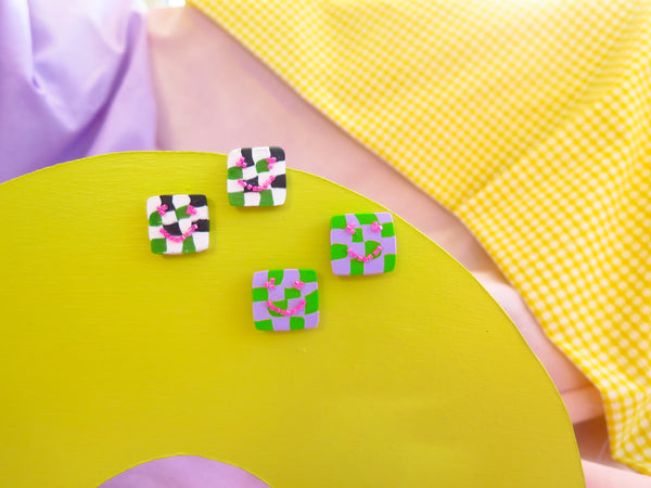 Baked by Lou polymer clay studs with checkerboard design and beaded smiley faces