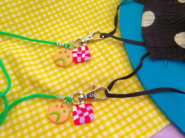 Baked by Lou, mask lanyard with sad face charms and silver swivel clasp detachable hooks