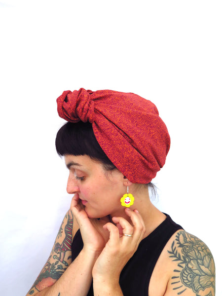 Hand sewn head wrap in neon green and black strobe stretch fabric