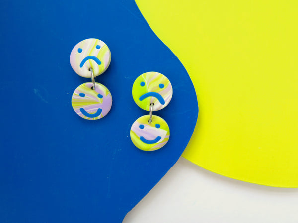 Baked by Lou statement happy face sad face earrings