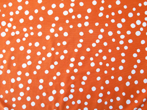 Hand sewn head wrap in orange and white polka dot stretch lycra fabric