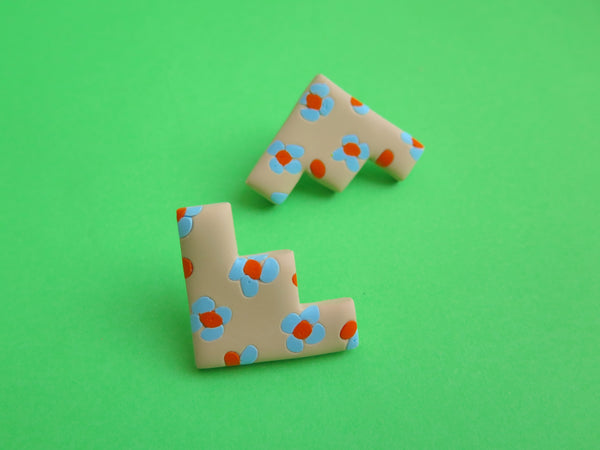 Clay geometric and floral studs by Baked by Lou