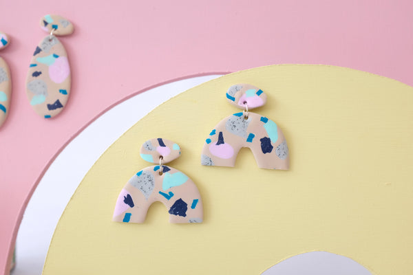 Statement arc earrings in a terrazzo abstract pattern