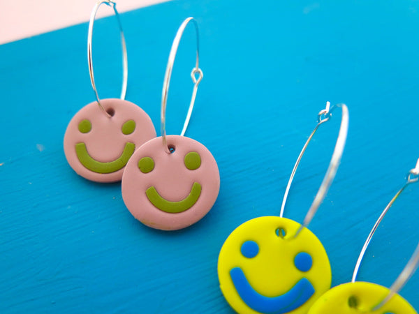 Small hoop earrings with smiley happy faces by Baked by Lou