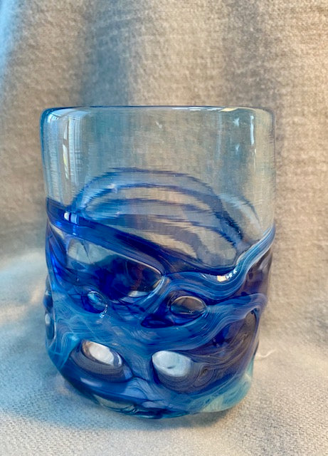 Blue wrapped glass