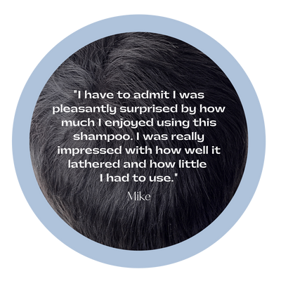 "Black hair with testimonial overlay, ""I have to admit I was pleasantly surprised by how much I enjoyed using this shampoo. I was really impressed with how well it lathered and how little I had to use."""