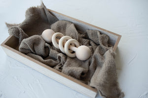 Wooden baby rattle with wood rings