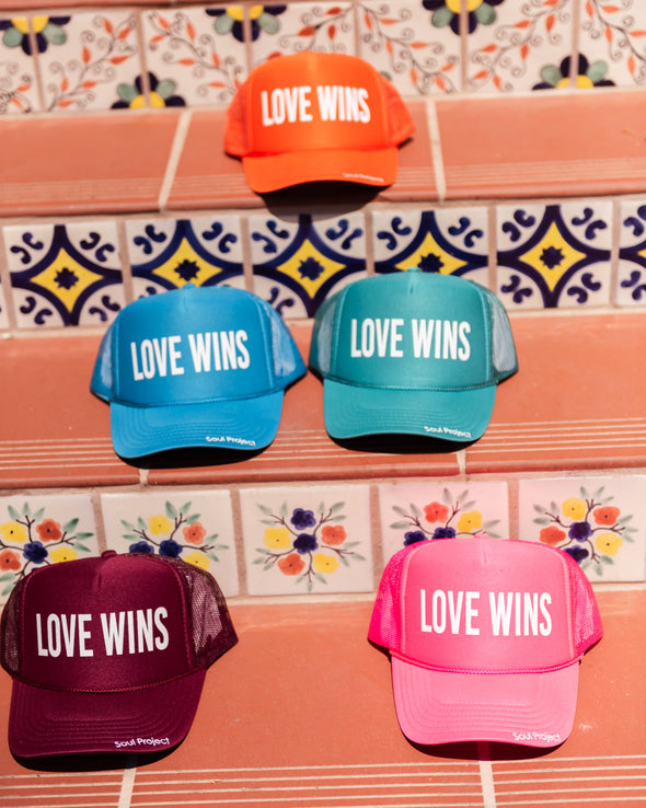 Love wins trucker hats.Love Wins trucker hat, hand printed in Laguna Beach CA at The Soul Project  100% Polyester Front, 100% Nylon Mesh Back 5-panel cap Plastic Adjustable Back Snap