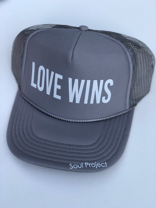 Love Wins trucker hat, hand printed in Laguna Beach CA at The Soul Project  100% Polyester Front, 100% Nylon Mesh Back 5-panel cap Plastic Adjustable Back Snap