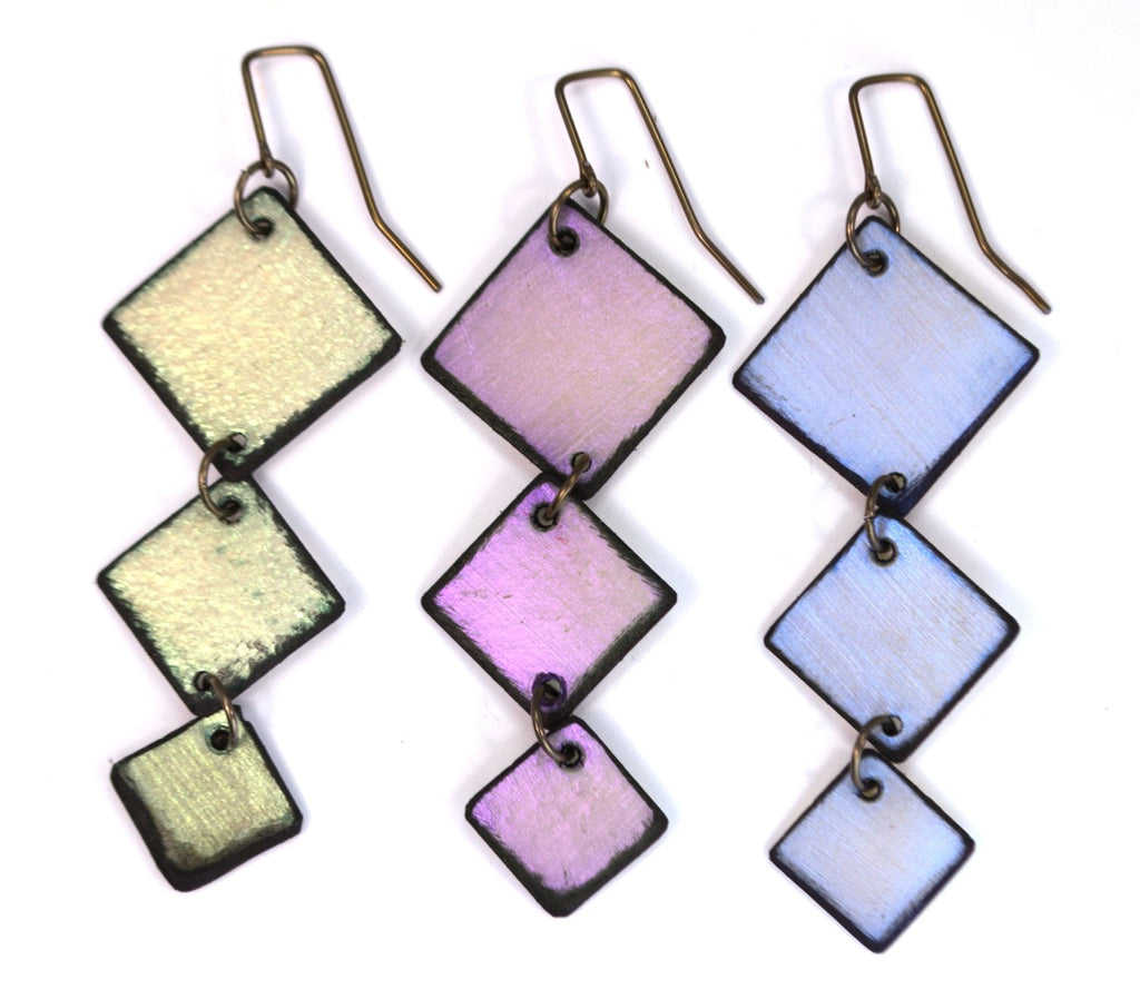 Square Dance earrings in three iridescent colors. Made from lightweight rawhide. Made in Wyoming. Made in the USA