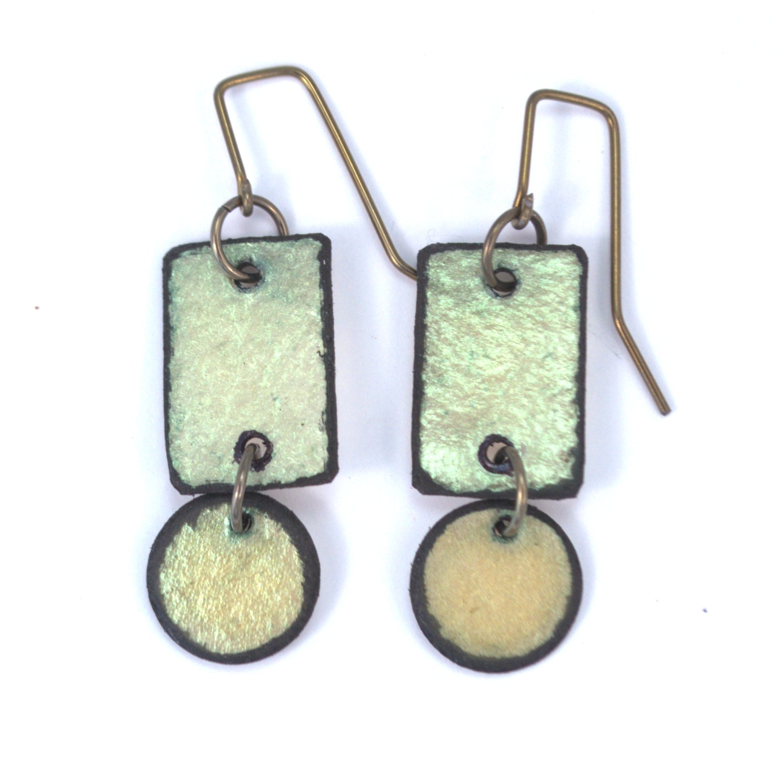 Lazy Circle earrings made from rawhide. Iridescent green earrings, hypoallergenic ear wires