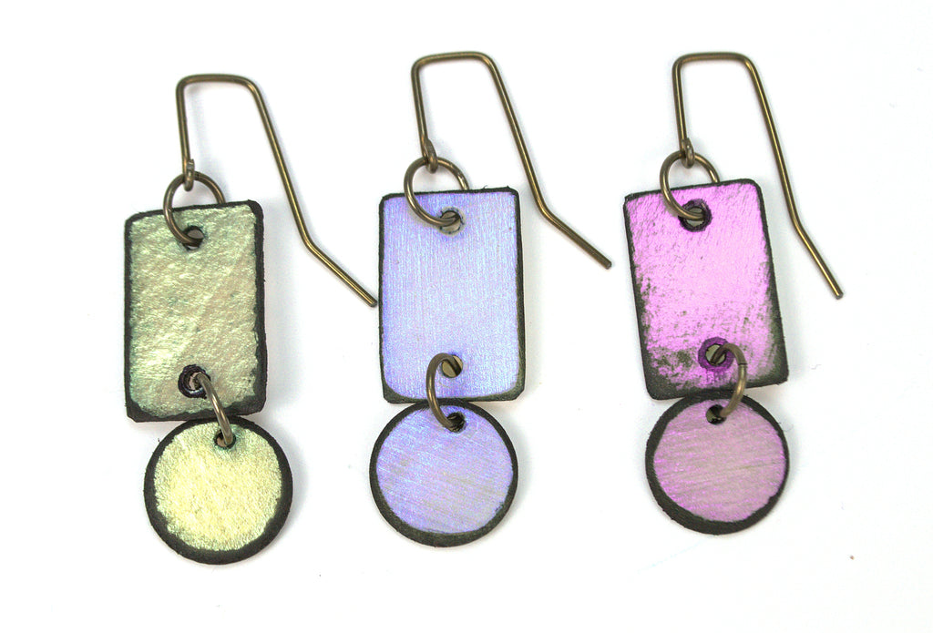 Lazy Circle earrings made from lightweight rawhide in three iridescent colors. Blue, green, violet