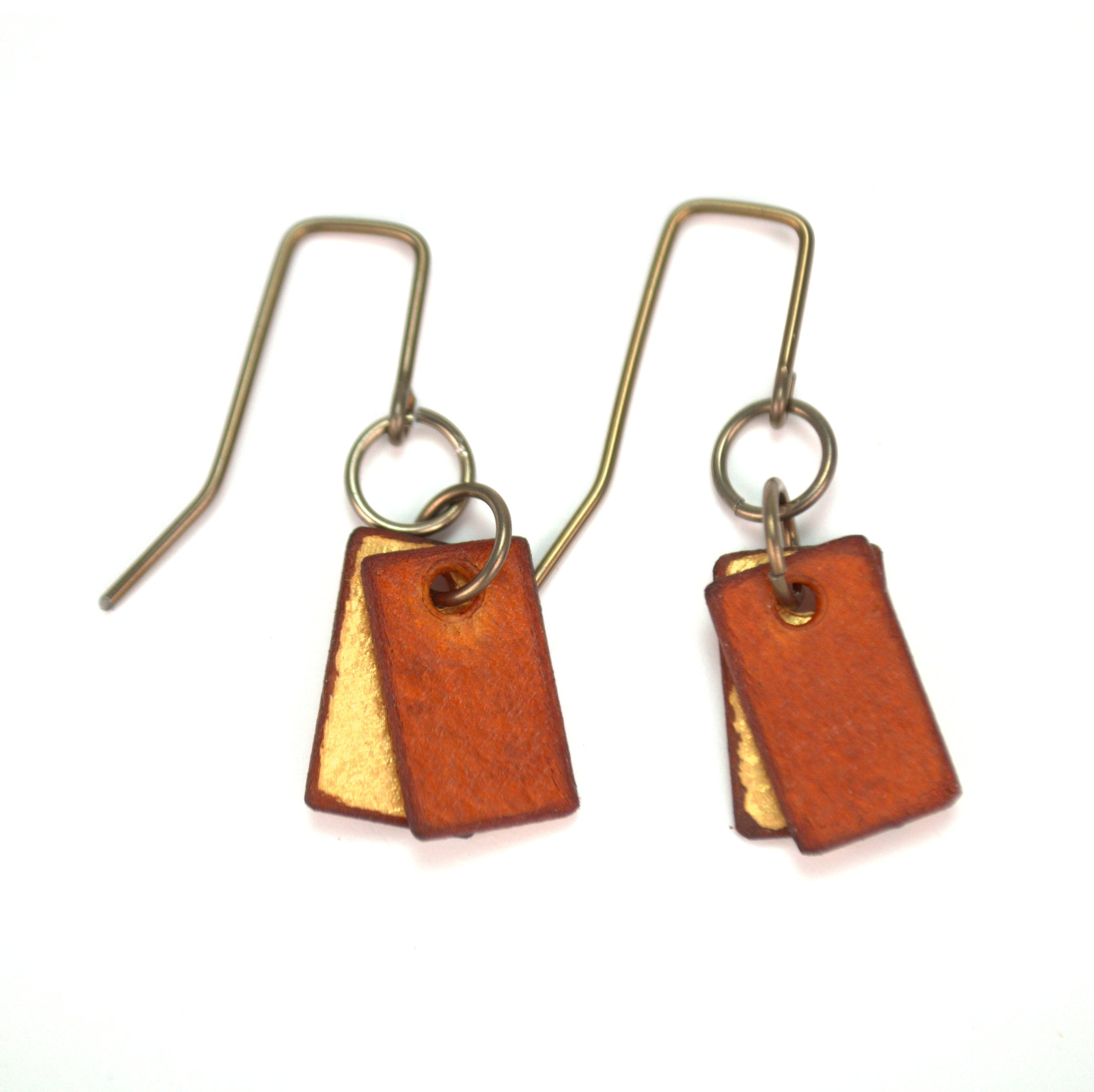 Min brown rectangle earrings, made from rawhide in Cheyenne Wyoming, hypoallergenic
