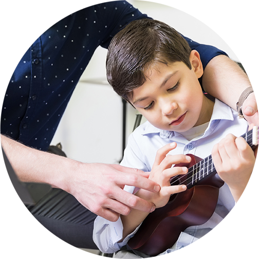 Child taking ukulele lesson