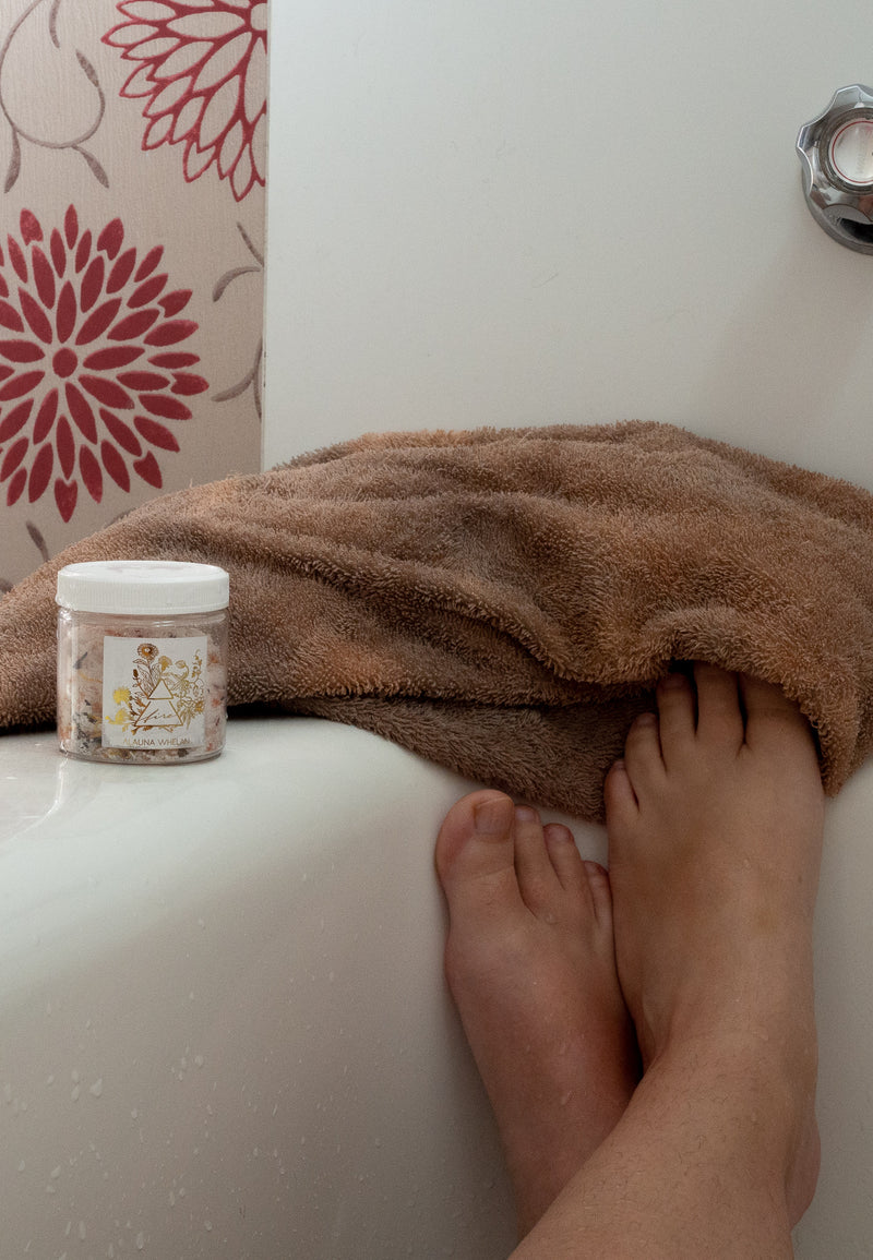 woman's legs, towel, bath tub and bath salts