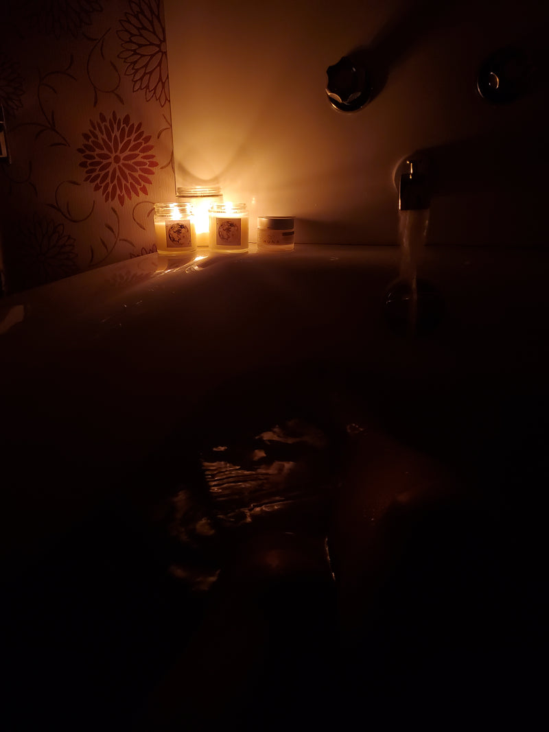 full bath tub with candlelit ambiance