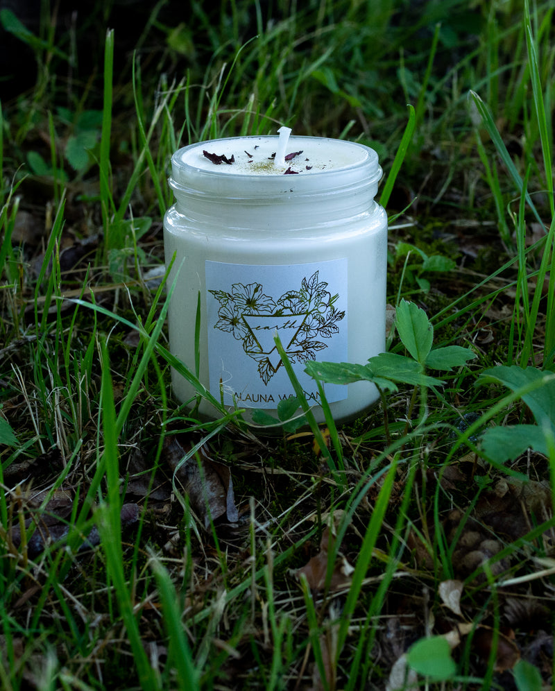 earth petrichor scented intention candle in nature