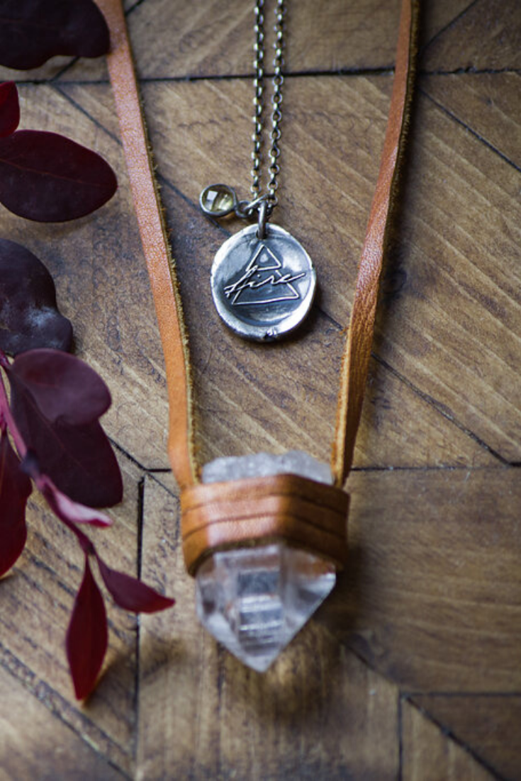 raw stone and leather necklace with rustic silver fire talisman medallion