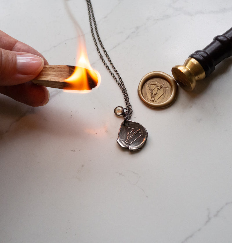 silver fire sign necklace with fire and wax seal