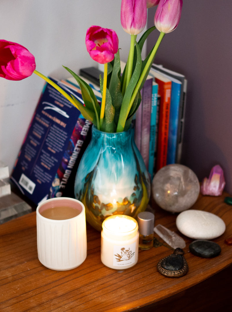 soy intention candle with tulips, crystals, and coffee