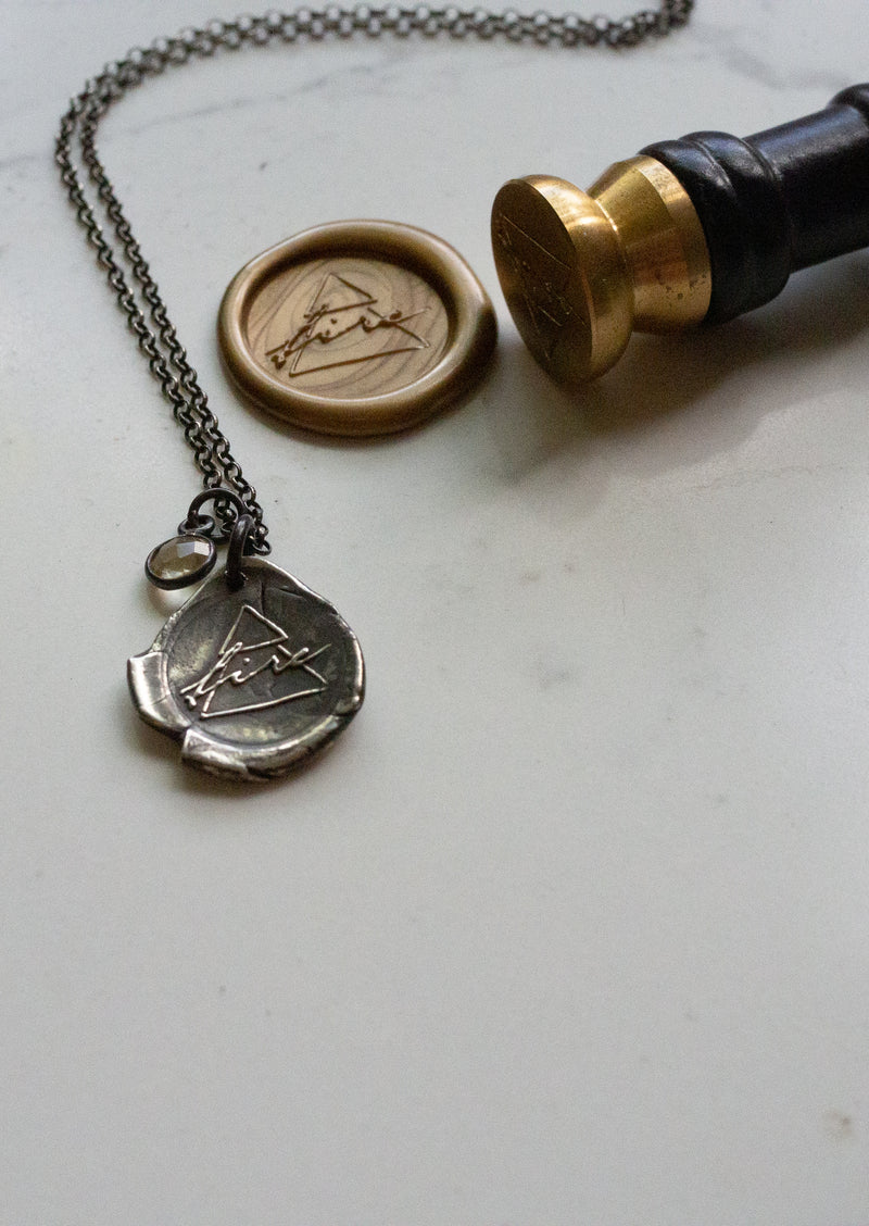 silver fire sign medallion necklace with wax stamp and seal