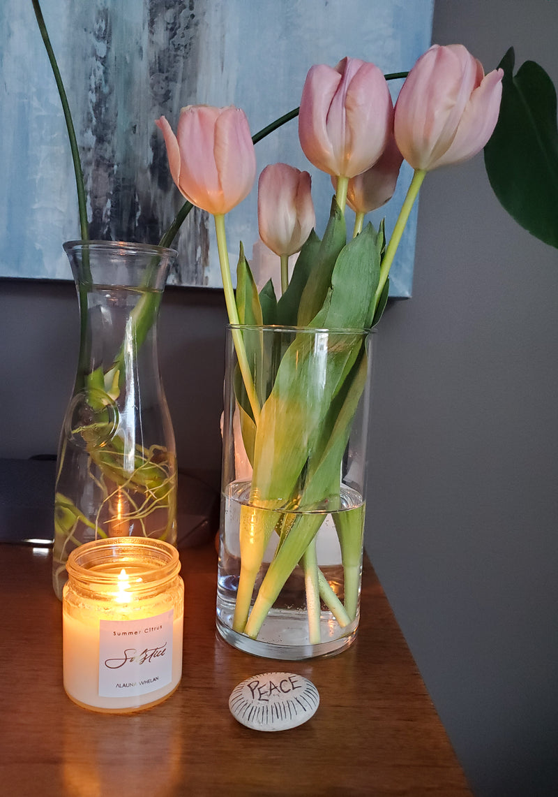 soy summer solstice candle with peace rock and tulips