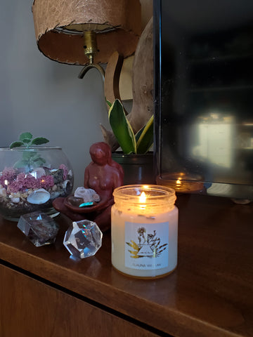air sign intention candle with crystals and altar