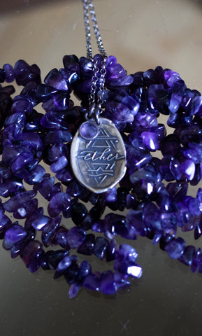 spiritual silver boho medallion layering necklace with purple crystals