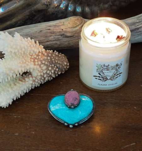 blue and pink crystal altar art with coral driftwood and soy candle