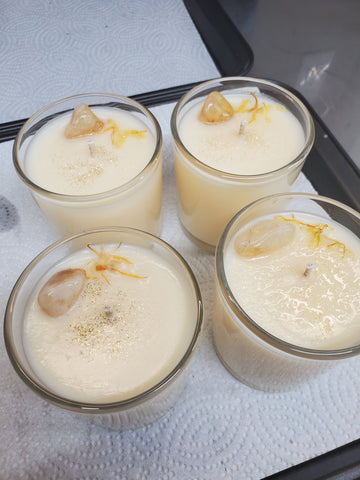 4 soy candles topped with orange crystals and herbs