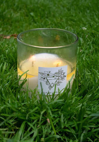 earth intention candle in grass outside