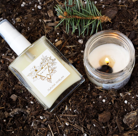 earth element candle and ritual mist on dirt