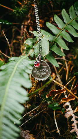 earth sign medallion silver necklace with foliage